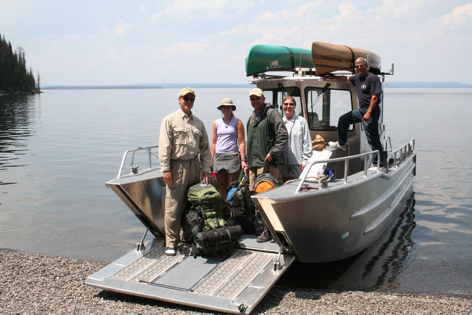 Group of people posing on a boat