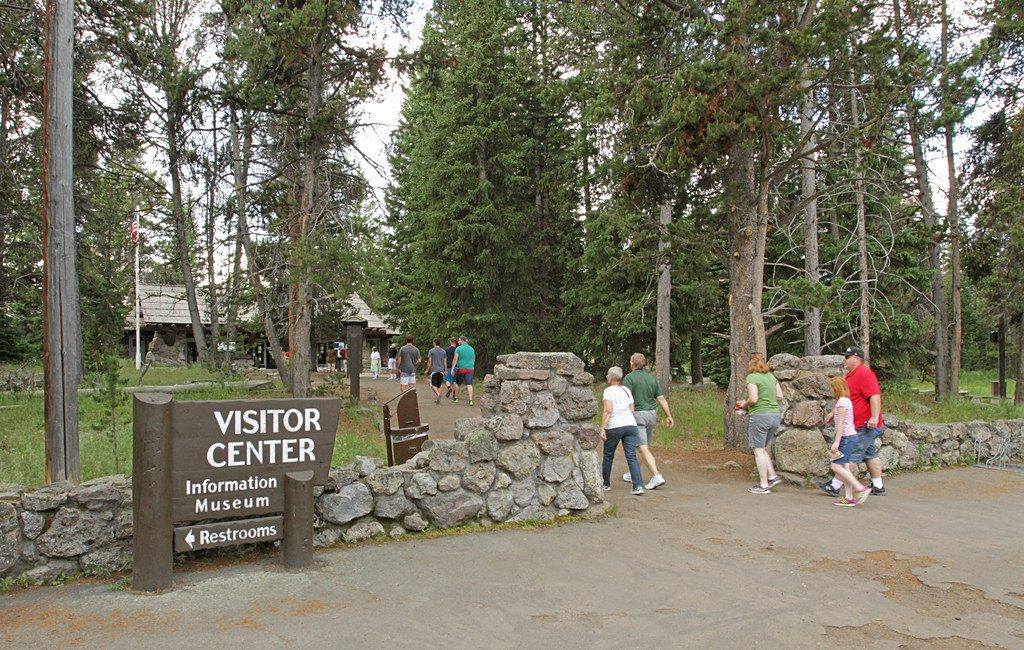Group of people walking towards the visitor center