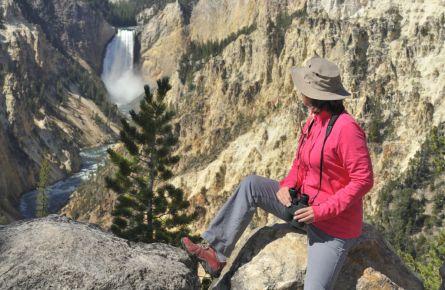 Woman looking at waterfall and Yellowstone