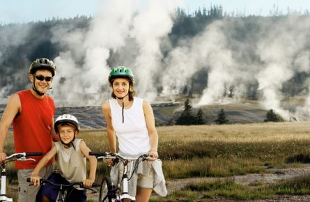 Family bike riding at old faithful