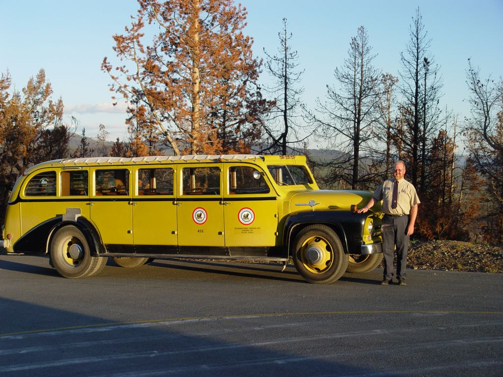 Leslie Quinn in front of a historic Yellow Bus