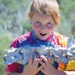 Young girl holding animal bones