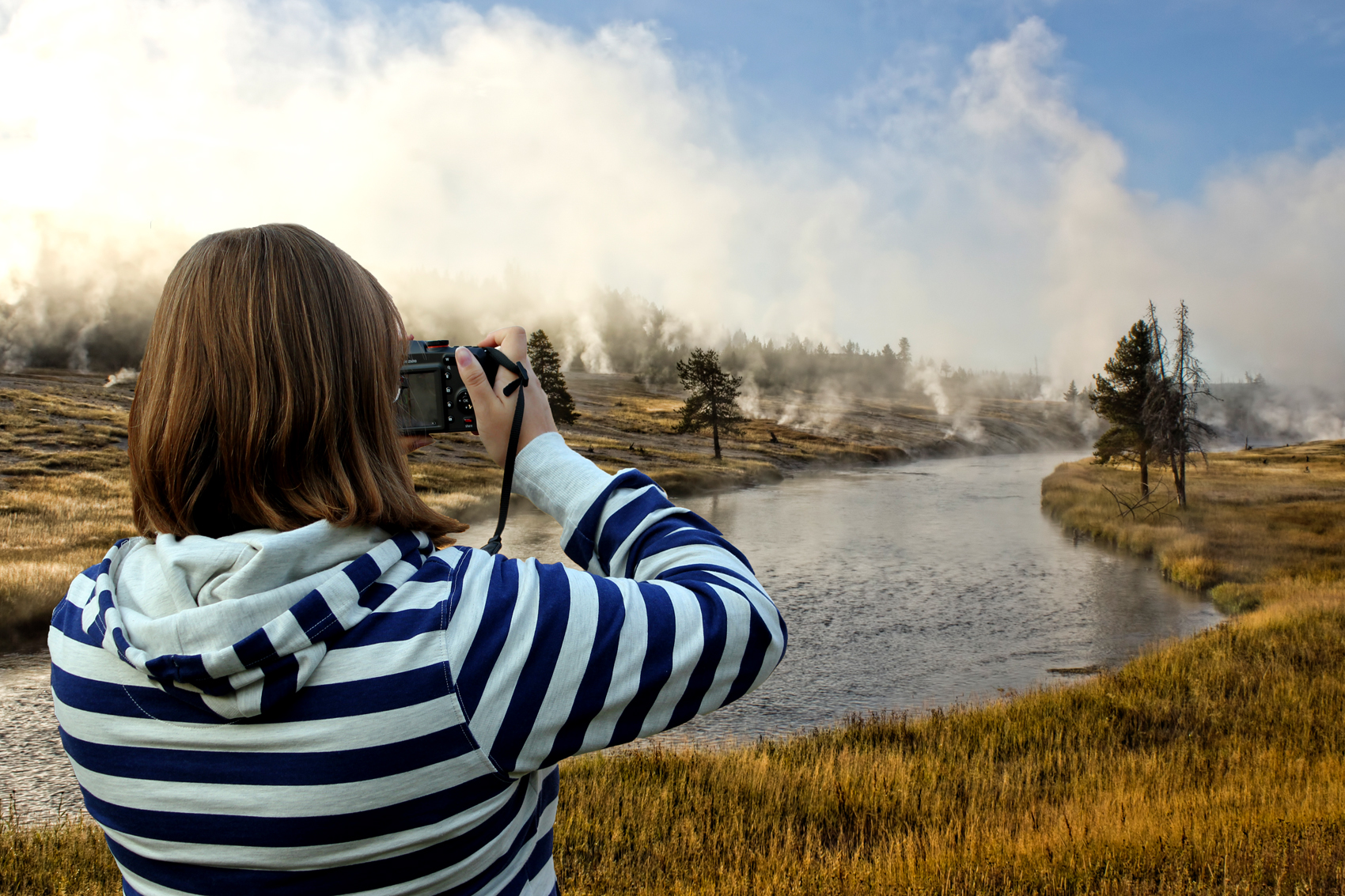 Woman taking a picture of a landscape
