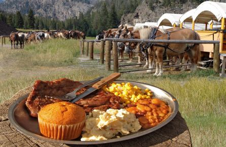 Cookout plate with horses and stagecoaches in the background