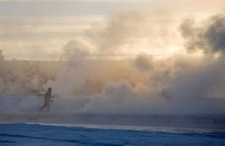A Skier passing Thermals close to Old Faithful