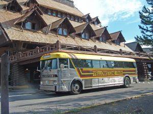 Yellowstone Park Bus departing Old Faithful Inn