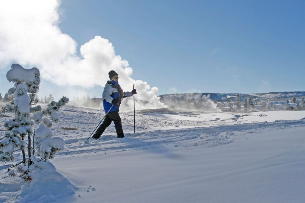 Person cross-country skiing at Old Faithful
