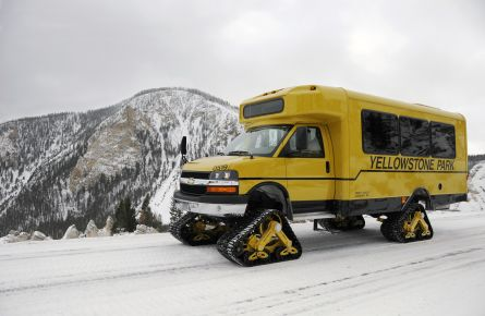 Glaval snowcoach with snowy hills in the background