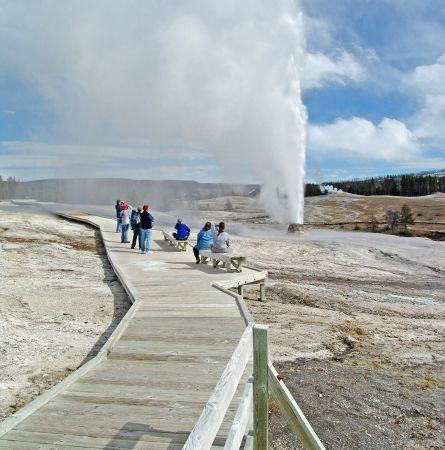 Crowd on boardwalk watching Behive geyser