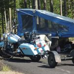 Motorbike and tent trailer at Madison Campground