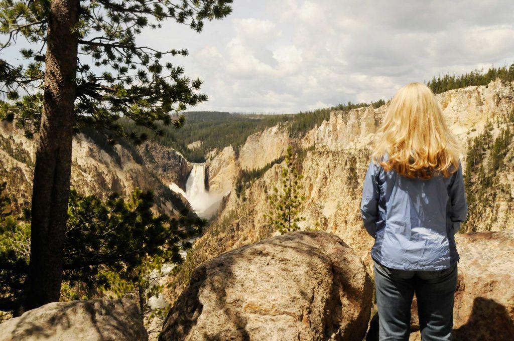 Woman watching waterfall at Grand Canyon of Yellowstone