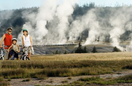 Family biking at Old Faithful