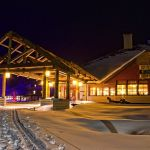Old Faithful Snow Lodge exterior view at night in winter