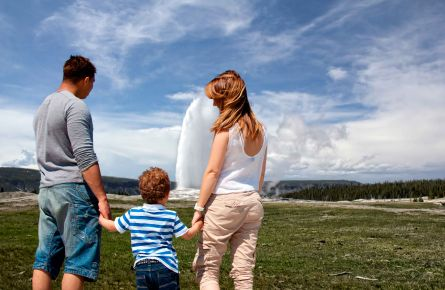 Family in front of geyser