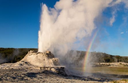 Castle Geyser Erupting with Rainbow