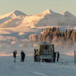 Snowcoach sunrise on Swan Lake Flat