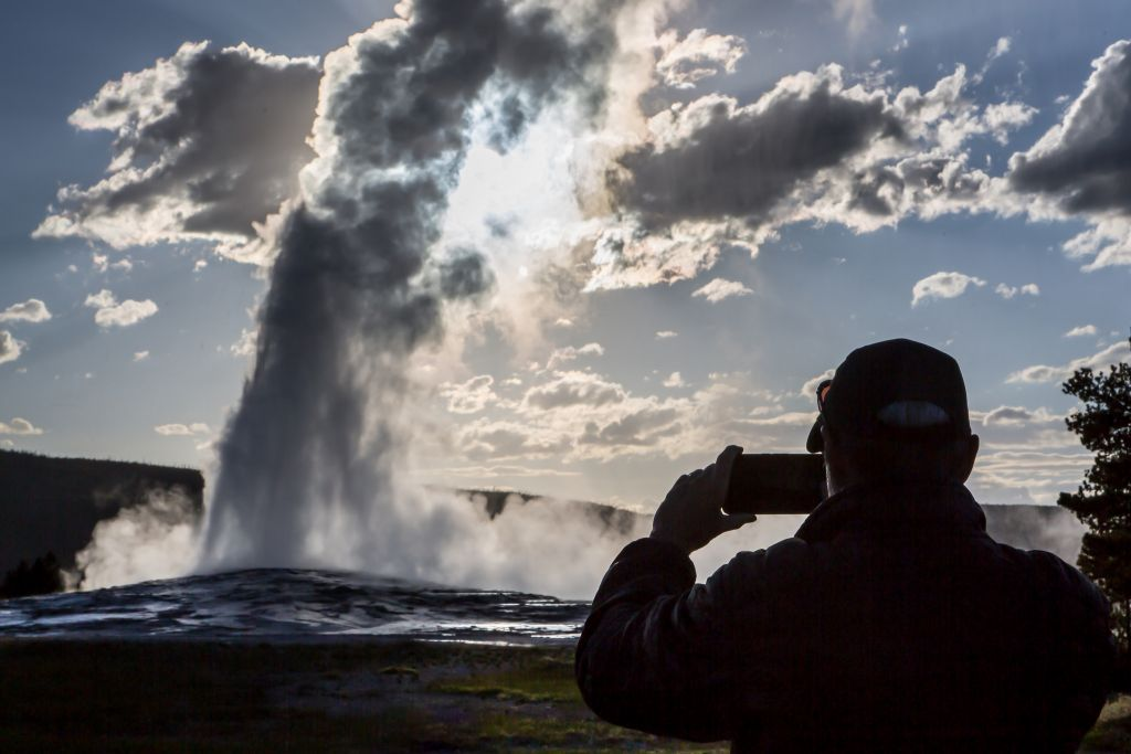 Photographing Old Faithful at Sunset