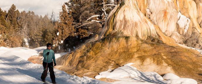 Skier in Front of Orange Spring Mound