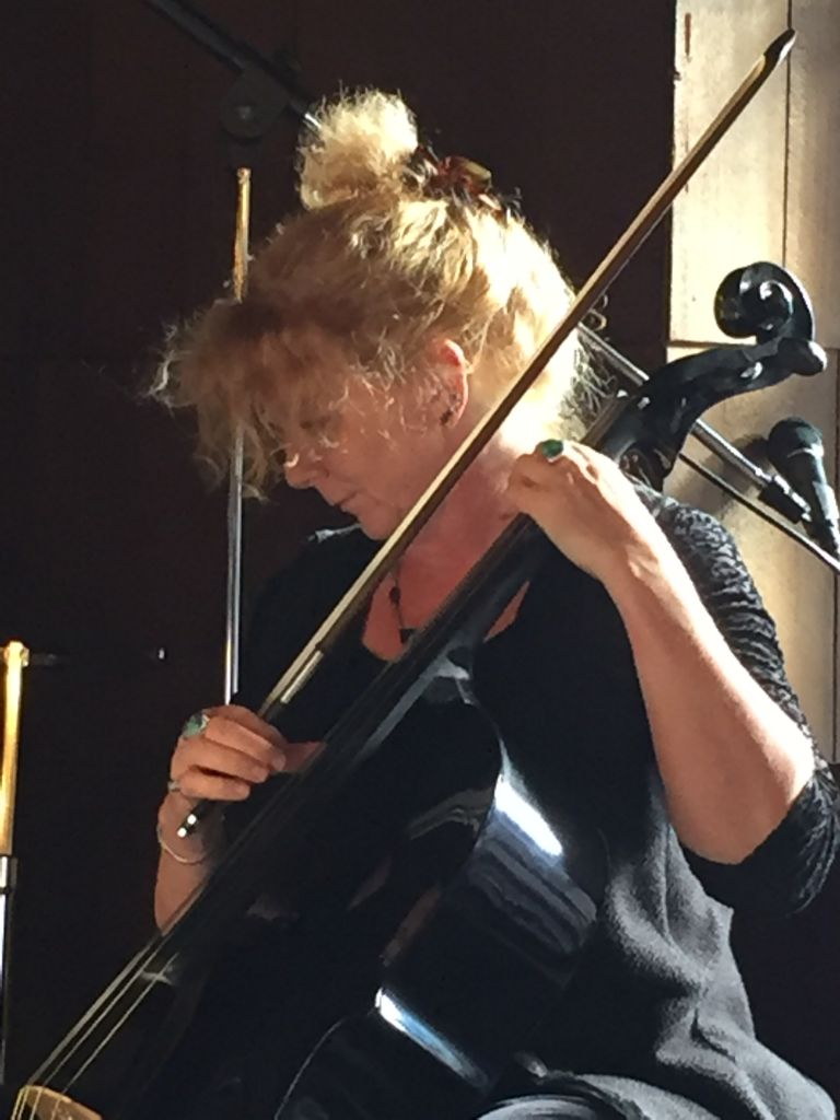 Musician Martha Colby plays at Yellowstone National Park.