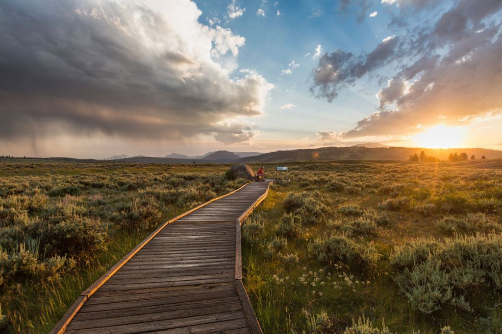 A wooden trail at sunset.