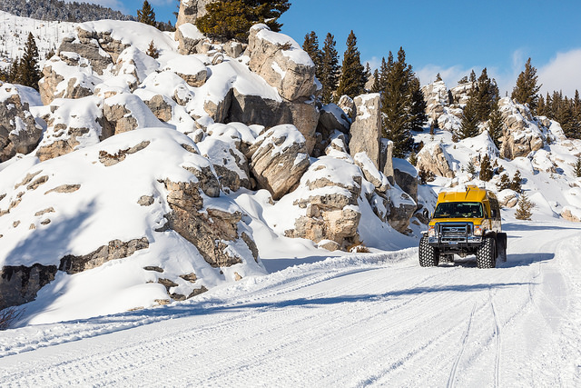 Snowcoach riding through the Hoodoos