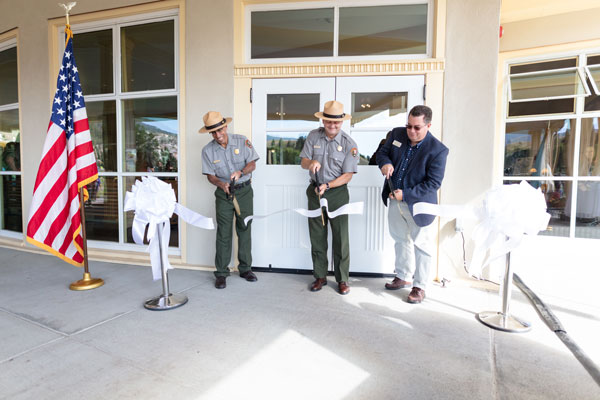 Cam Sholly and Mike Keller Cut the Ribbon to Officially open the renovated Mammoth Hot Springs Hotel